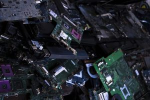 a pile of computer parts, motherboards, circuit boards, cooling fan, and more